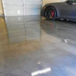 shiny-epoxy-garage-floor-beside-car