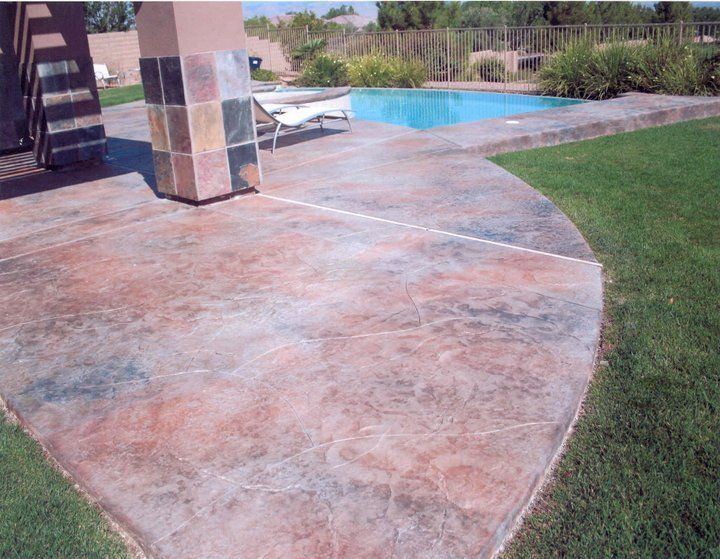 stamped concrete pool deck with staining